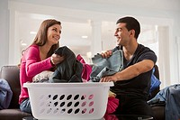 Couple sorting laundry together