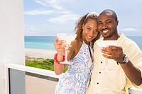 Couple having drinks on balcony