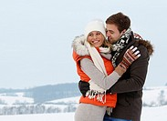 young couple take a walk in winter landscape