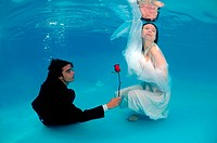 Bridal couple, underwater wedding in pool