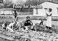 FSA SLIDE FILM, 1936. 'Food for health.' Photograph by Dorothea Lange, from a Farm Security Administration slide film, 1936.
