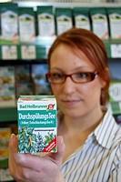 Woman buying Bad Heilbrunner flushing tea, purging tea, detoxification
