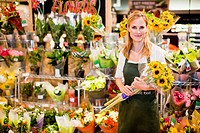 Grocer working in florist section