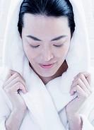 Woman wrapped in fuzzy bathrobe