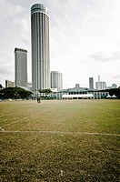 Playing field of Singapore Cricket Club, founded in 1852, in front of modern office building, Singapore, Southeast Asia, Asia