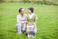middle aged couple in field with grass