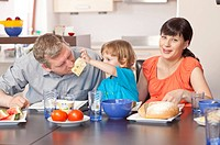 Happy family eating breakfast together.