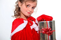 Little girl holding Christmas present