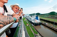 Tourists on balconies at Miraflores Locks visitors center. Panama Canal, Panama, Central America