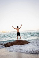 Man Celebrating On Beach