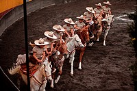 Escaramuzas ride their horses before competing in an Escaramuza competition in the Lienzo Charros del Pedregal, Mexico City, Sunday, March16, 2013. Es...