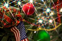 Artifical christmas tree with lights and American flag