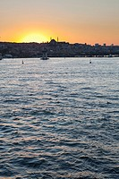 Turkey, Istanbul, View mosque with Golden Horn in foreground at sunset