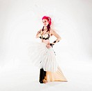 Pink haired belly dancer on white background in a studio shot. (CTK Photo / Cray Photo)