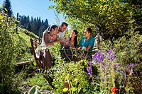 Austria, Salzburg Country, Family having garden party, smiling