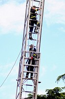 Firemen climbing up ladder