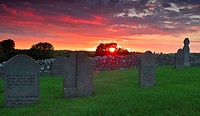 Sunset over and old graveyard near Killucan, County Westmeath, Ireland
