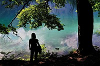 Girl watching the lake Fusine, Julian Alps. Italy
