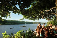 Caraíva, Bahia, Brazil, people hanging out at sunset along the river