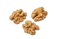 Peeled walnuts on white background