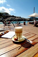 Cafe con leche, Latte Macchiato on a wooden desk, Cala Rajada, Mallorca, Spain