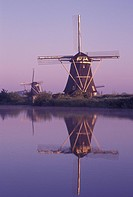 windmill, canal, Kinderdijk, Holland, Netherlands, Zuid-Holland, Europe, Mills of Kinderdijk, Working windmills along a canal in the early morning in ...