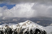 Clouds on the snow-capped summit of Mount Gamskarkogel, Austria.