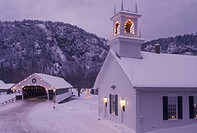 covered bridge, church, NH, New Hampshire, Stark, Christmas lights decorate the Stark Union Church and covered bridge in the evening in winter.