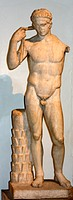 Roman statue of a victorious young athlete. 1st century AD. Remade from a Greek original of about 430 BC. The athlete shown tying a ribbon around his ...