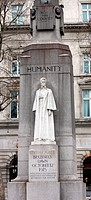 Memorial statue of Edith Cavell, British nurse and patriot. Set at Saint Martin's Place in London, England. Made of White marble against a tall granit...