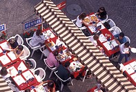 outdoor cafT, aerial, Geneva, Switzerland, Looking down at people eating at an outdoor cafT in the old town of the city of Geneva.