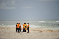 Oil spill response workers talking on the beach. Baldwin County, Alabama. June 2010.