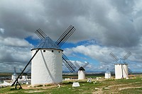 Typical windmills in Campo de Criptana village, in the Route of Don Qiuijote, Ciudad Real province, Castilla-La Mancha, Spain.
