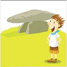 a kid standing next to the dolmen