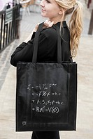 A popular item of merchandising supplied by CERN is this shopping bag which carries the 'Standard Model equation' describing the current understanding...