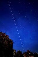 International Space Station in the sky. Time-exposure image showing the path (central line) of the International Space Station (ISS) as it passes thro...