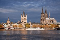 Church of Gross St Martin and Cologne Cathedral with River Rhine, Cologne, Rhine-Westphalia, Germany.
