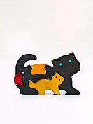 A colorful miniature wooden cat model