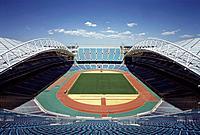 SYDNEY OLYMPICS, HOMEBUSH BAY, SYDNEY, AUSTRALIA, BLIGH LOBB SPORTS ARCHITECTURE, EXTERIOR, STADIUM AUSTRALIA _ GENERAL SHOT FROM END OF STADIUM.