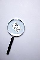 a bar code under a magnifying glass