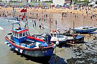 Broadstairs, Kent, England, UK. Fishing boats on the beach at low tide.
