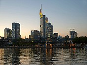 river Main in evening light with the Bridge Eisener Steg with lightened skyline with bank office towers in the background Frankfurt am Main Hesse Germ...