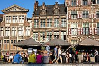 Tourists at pavement café on the Graslei / Grass Lane in summer in Ghent, Belgium
