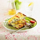 Vegetable frittata and salad garnish on a plate, with a fork