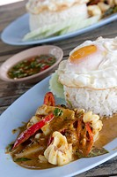 Thailand, Koh Sirey, squid with spicy chillies, rice and fried egg (Pla Muek Pad Prik)