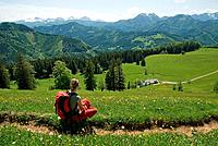 female hiker with view on the Gschwendtalm, Austria, Upper Austria, Kalkalpen National Park