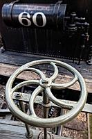 Metal wheel on old steam locomotive, Idaho Springs, Colorado.