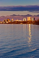 View Of The Anchorage Skyline Reflecting In The Waters Of Cook Inlet At Sunset, Southcentral Alaska, Fall