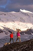 Switzerland, Europe, mountain, mountains, canton, Valais, glacier, ice, moraine, man, woman, couple, walking, hiking, Glacier de Combassiere, Grand Co...