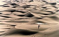 Hangliding over the dunes of the Sahara Desert.